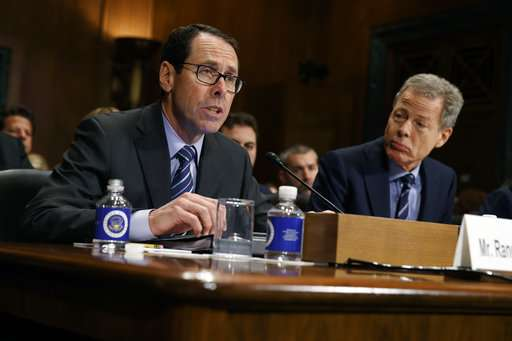 Politics or policy? Behind the dispute over AT&T-Time Warner