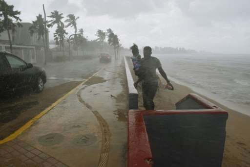 Puerto Rico is already experiencing strong wind and rain as Hurricane Maria approaches