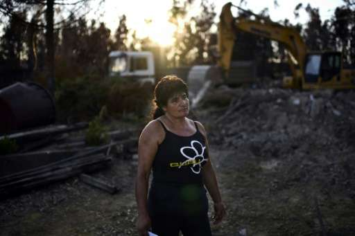 """We lost everything,"" said Edite Godinho, watching a bulldozer demolish the charred remains of her home in Vale da Nog"