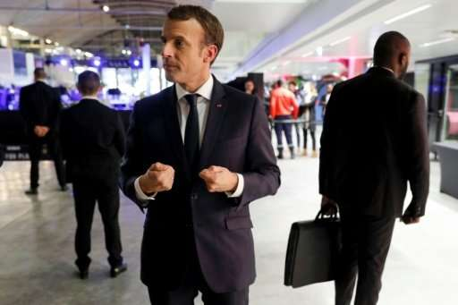 """Without much stronger mobilisation, a jolt to our means of production and development, we will not succeed,"" Macron w"
