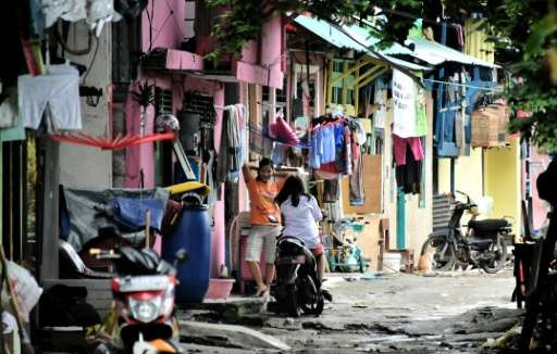 Residents of Tongkol kampung have transformed the neighbourhood into a model of clean and green living in an effort to fight off