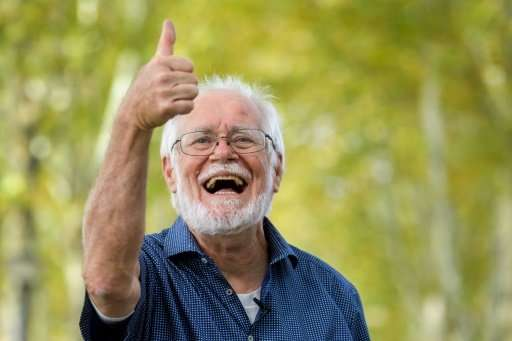 Small is beautiful: Swiss Scientist Jacques Dubochet gives a thumbs-up after being named as one of three winners of this year's