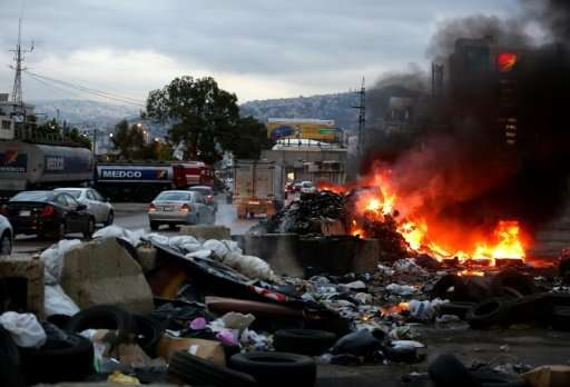 Smoke billows from a burning garbage dump on the northern entrance to the Lebanese capital, Beirut, on October 26, 2015