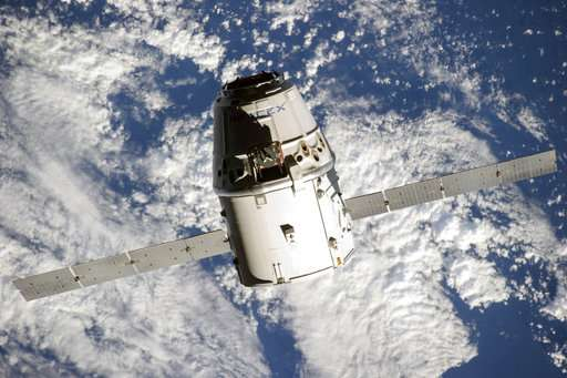 SpaceX craft returns to Earth after second space station trip