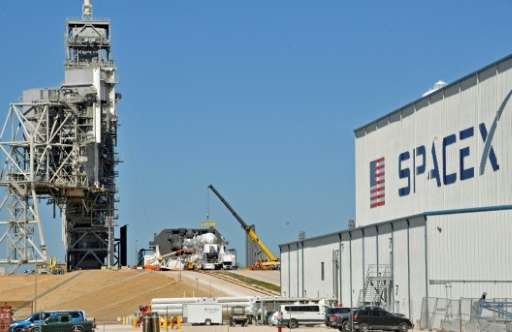 Space X's Falcon 9 rocket is prepared for  launch to the International Space Station  at the Kennedy Space Center, on a renovate