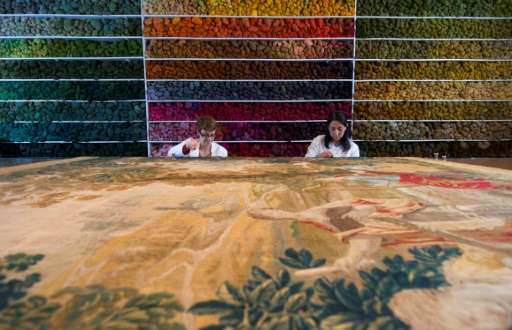 Specialists work at the Royal Manufacturers De Wit in Belgium currently the world's biggest restorer of old tapestries