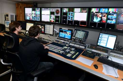 Technicians work on TV programs at the headquarters of sports television network, Eurosport, in Issy les Moulineaux, France