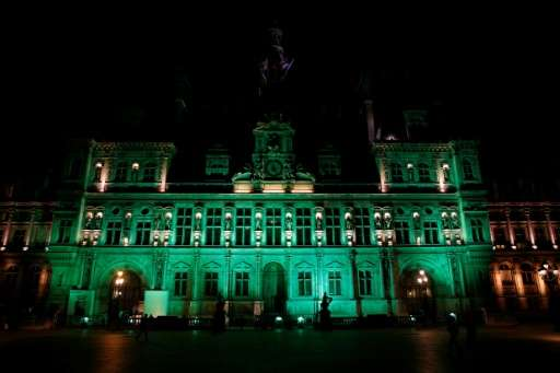The City Hall of Paris illuminated in green following the announcement by US President Donald Trump that the United States will