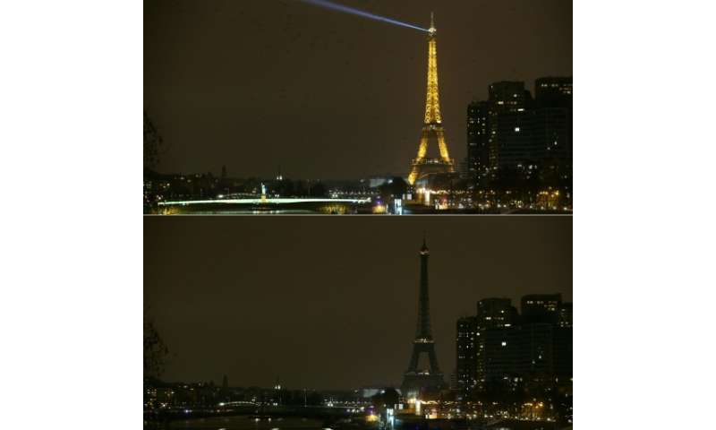 The Eiffel Tower in Paris shown before and after it went dark for Earth Hour