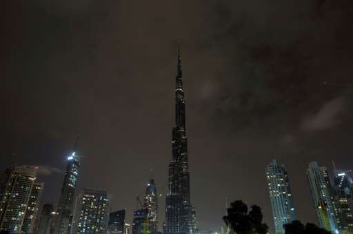 The lights on the Burj Khalifa tower, the world's tallest building, are switched off for an hour in Dubai