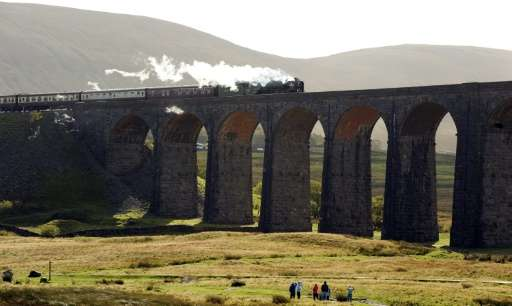 The Peppercorn Class A1 60163 Tornado steam train travels over the Ribblehead Viaduct in Ribblehead, nortern England, for the fi