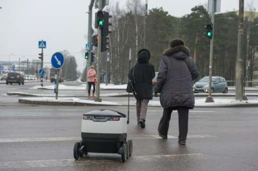 The robot can communicate with humans when it needs to cross the street or gain access to a building