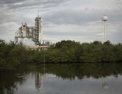 The SpaceX Falcon 9 rocket, with the Dragon spacecraft onboard, is seen at Launch Complex 39A at NASA's Kennedy Space Center in