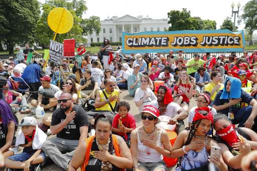 Thousands brave weather to protest Trump climate policies