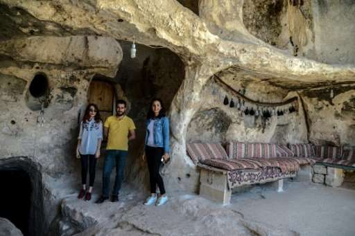 Tourists in the caves at  Hasankeyf. Turkish authorities have said they will rehouse residents displaced by the dam project