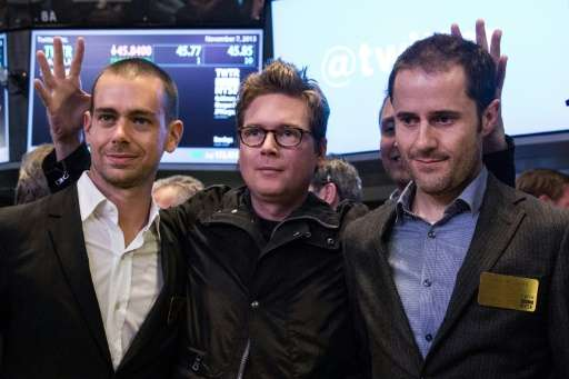 Twitter co-founder Biz Stone, at center in 2013 photo at the New York Stock Exchange debut of the social network, is flanked by
