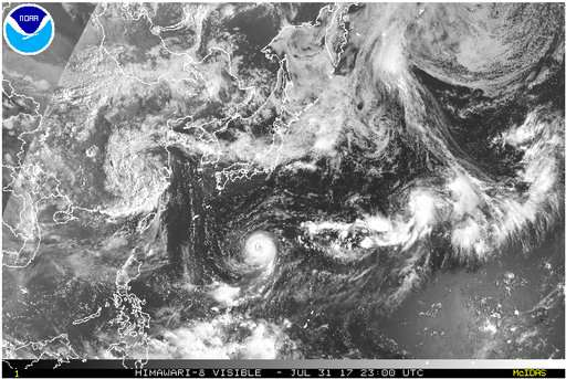 Typhoon weakens but could still threaten Japan
