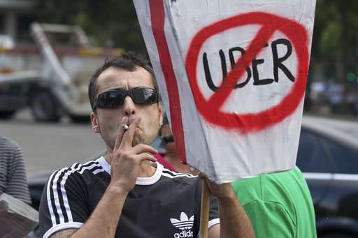Uber's airport service in Madrid under attack from town hall