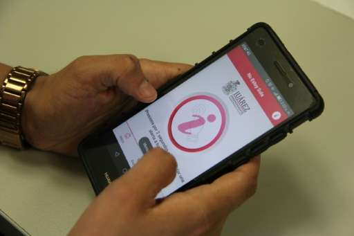 View of a new app released by Juarez's city hall to help women in distress send alert signals by simply shaking the phone or pre