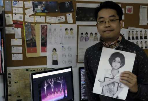 Yao Shuen-ting, a co-founder of game developer Red Candle Games, displays a key figure of the video game 'Detention' during an i