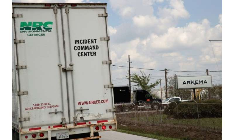An environment services vehichle enters the main gate of the Arkema plant that received major damage from flooding caused by Hurricane and Tropical Storm ...
