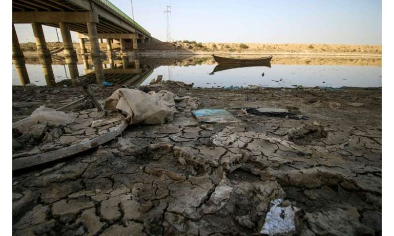 A picture taken on March 20, 2018 shows a view of the dried-up shore of an irrigation canal near the village of Sayyed Dakhil, s