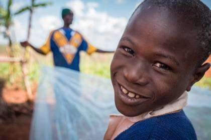 A plan to distribute insecticide-treated bed nets annually to children in schools