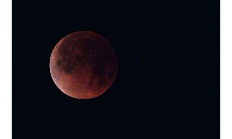 "A ""blood moon"" seen in January: On Friday, the longest such eclipse this century can be seen in the sky near Mars, whi"