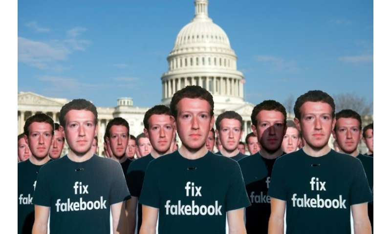 Cardboard cutouts of Facebook founder and CEO Mark Zuckerberg outside the US Capitol ahead of his testimony before Congress