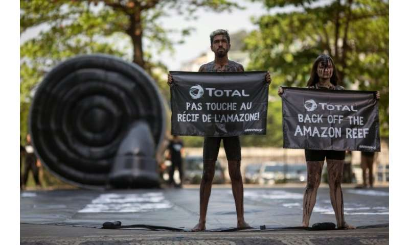 Greenpeace activists stage a protest in Rio de Janeiro against Total's planned oil exploration near a huge coral reef off the co