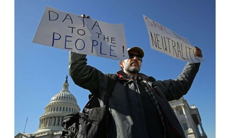 "Protesters in Washington on February 27 urged lawmakers to reverse regulators and restore ""net neutrality"" rules that"