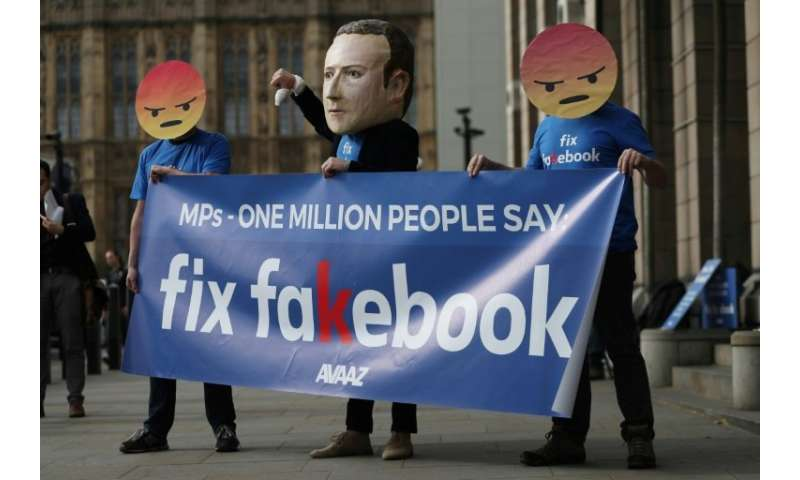 Protestors demonstrated outside Portcullis house in London where Facebook's Chief Technology Officer Mike Schroepfer was grilled