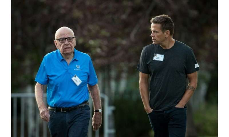 Rupert Murdoch and son Lachlan Murdoch, seen at a conference in 2017, share the title of executive chairman at News Corp, the ne