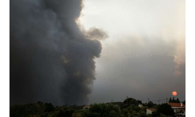 Smoke rises from a wildfire close to Monchique in the Algarve, southern Portugal, where more than a 1,000 firefighters are battl