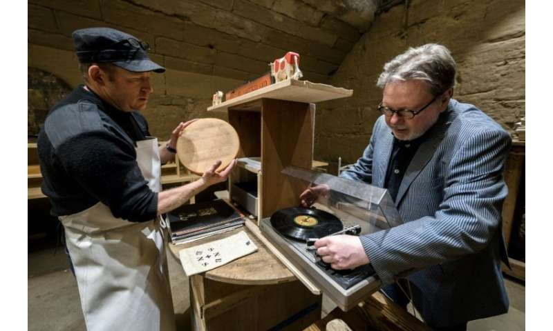 Swiss cheesemaker Beat Wampfler (L) and director of the Music Department at University of the Arts in Bern, Michael Harenberg. w