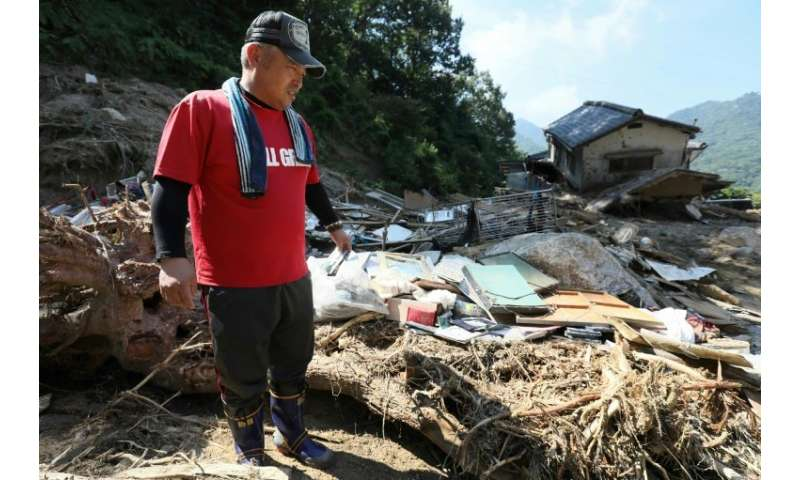 Tens of thousands of rescue workers are still digging through the debris for bodies after Japan's worst weather-related disaster