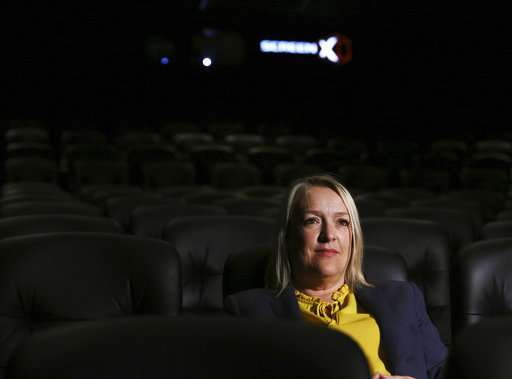 To fend off Netflix, movie theaters try 3-screen immersion
