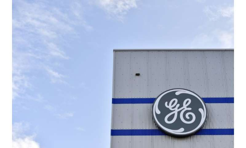 Troubled US industrial giant GE reports a $22.8 billion third quarter loss as it writes down assets as part of a turn-around bid