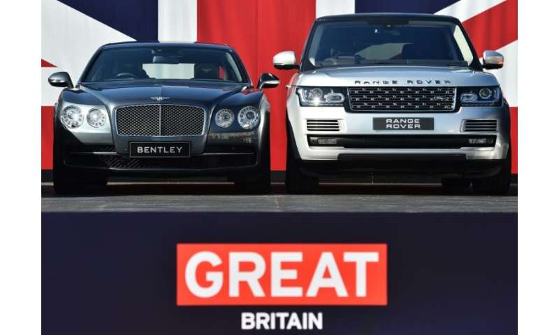 Two British built-cars, a Bentley Flying Spur and a Range Rover, pictured in London in 2015