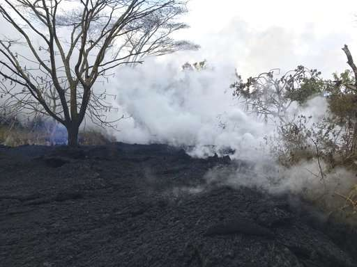 Quakes damage roads as ash spews from Hawaii volcano