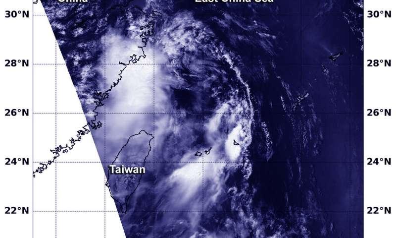 NASA finds Tropical Depression 13W hugging southeastern coast