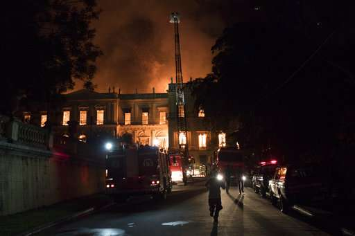 Firefighters try to save relics as fire engulfs Rio museum