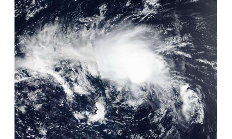 NASA satellite image Tropical Depression Hector elongating, weakening