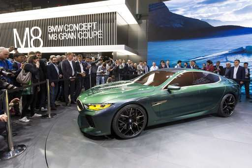The Latest: Aston Martin combines luxury and electric power