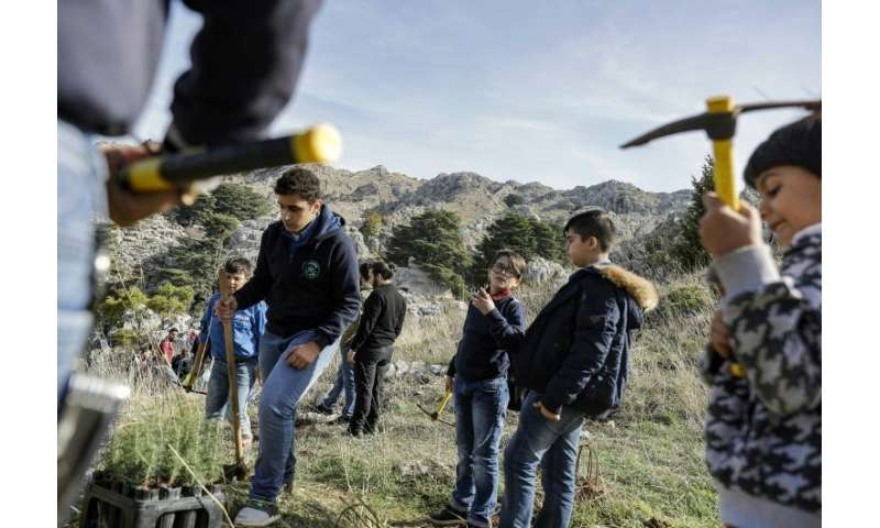 "Activists from Lebanese NGO Jouzour Loubnan (""Roots of Lebanon"") gather to plant young cedars"