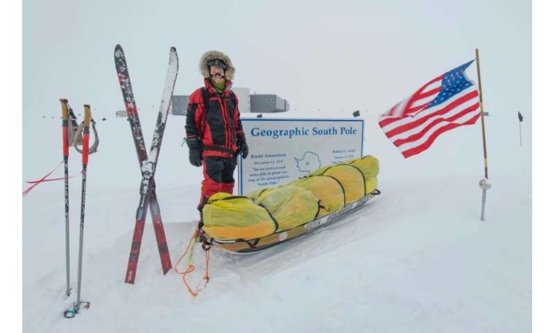 American adventurer Colin O'Brady poses for a photo at the Geographic South Pole sign in Antarctica