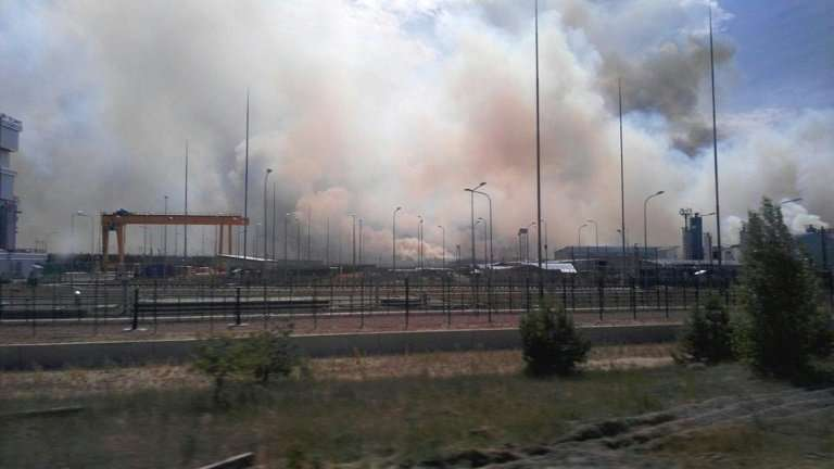 A picture taken with a mobile phote shows smoke rising near the Chernobyl nuclear power plant on June 4, 2018, after a wildfire