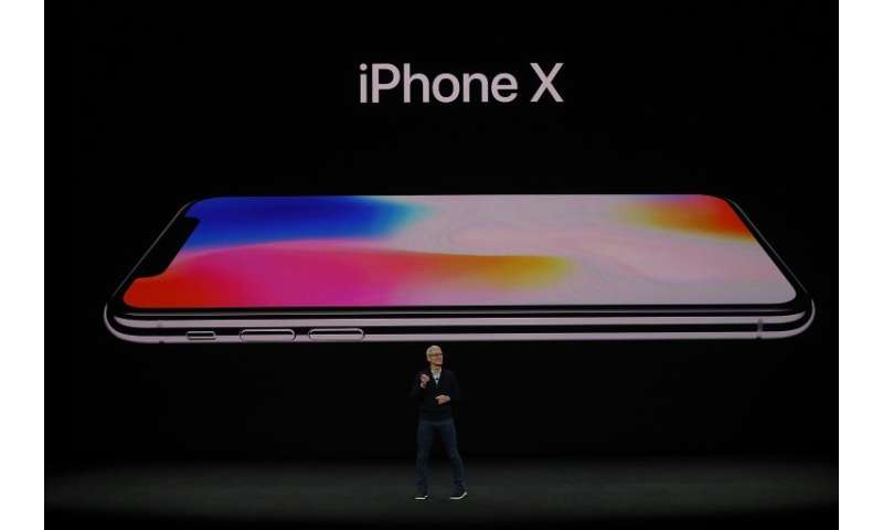 Apple CEO Tim Cook announces the new iPhone X during an event at the Steve Jobs Theatre on the Apple Park campus on September 12