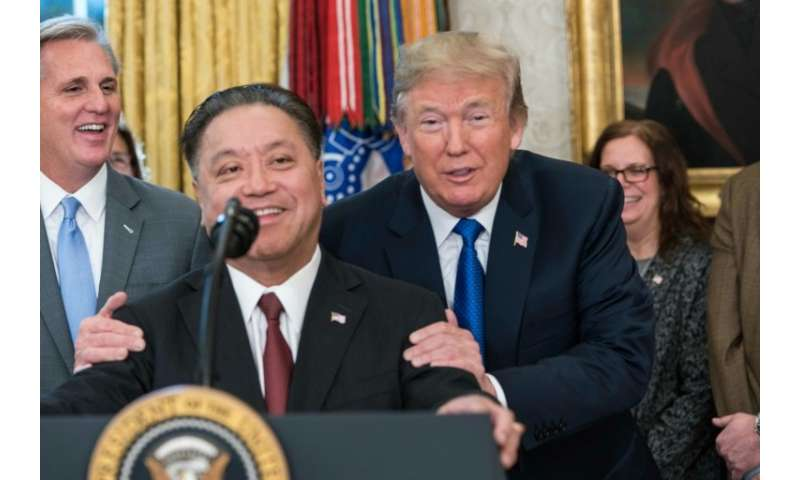 Broadcom CEO Hock Tan is seen at a November 2017 White House meeting with President Donald Trump where he announced the Singapor