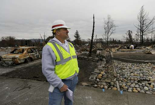 California wildfire victims say cleanup crews add to woes